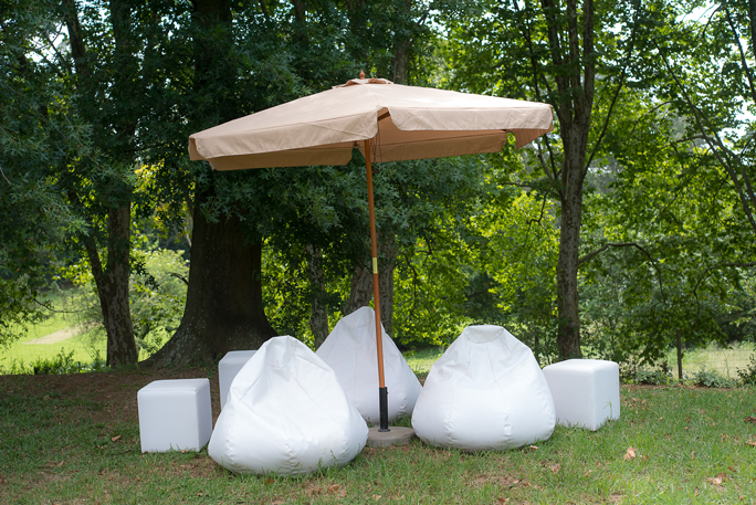 Laurie Kohrs White Ottomans Bean Bags Umbrella Midlands Wedding Seating